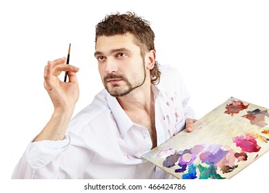 Painter with brush and palette in action . Isolated over white