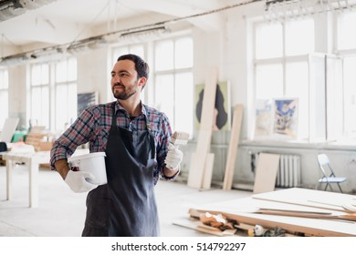 Painter with a can and brush at his work room