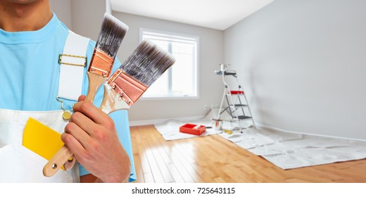Painter hand with painting brush
