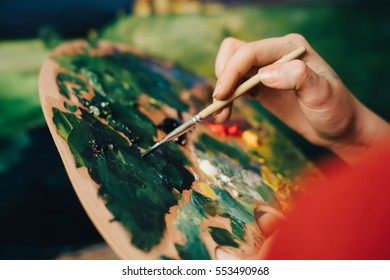 painter holding a brush in his hand