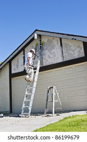 Painter makes his way up the ladder.