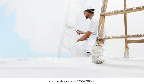 painter man at work, with wooden ladder and  blank wall for copy space, web banner template