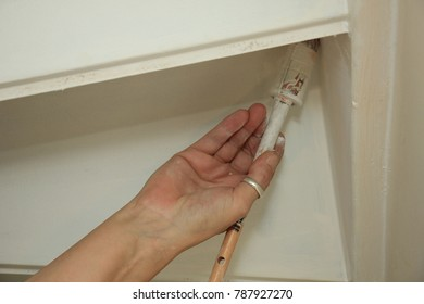 A painter painting a staircase, indoor job