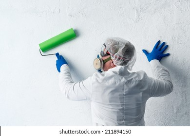 Painter preparing to paint the wall