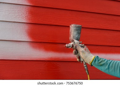 Painter squirt color for change color on wooden wall.