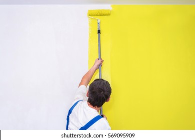 Painter use paint roller on white wall