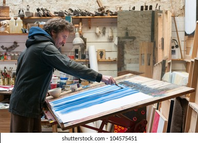 painter working at workshop studio