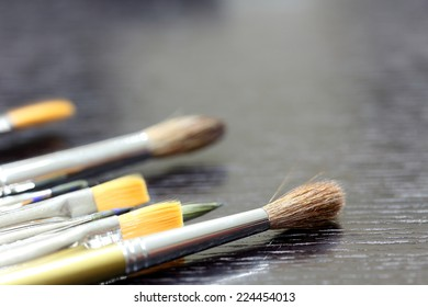 Painter's Brushes on Table