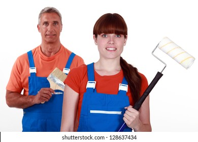 painters in overalls holding brushes