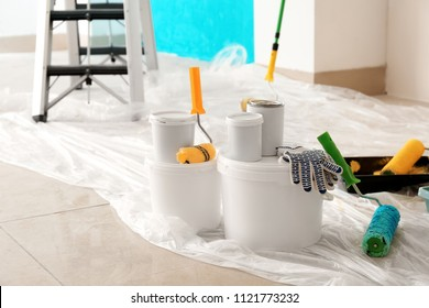 Painter's tools on floor indoors