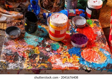 painters well used palette full of color and rough haphazard texture