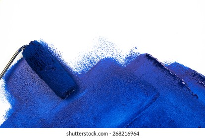 painting blue with paint roller on white background