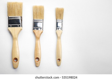 Painting brushes on white textured background