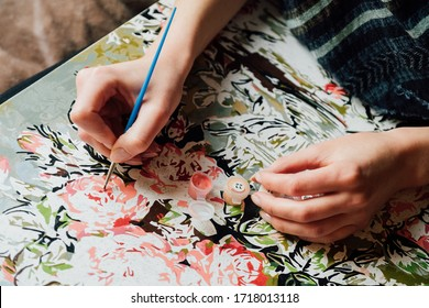 Painting by numbers concept. Young girl enjoying coloring picture by numbers. Creative hobby. Leisure activity at home during self-isolation COVID-19