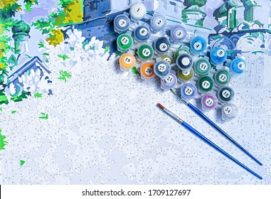 Painting by numbers. Set to paint the picture, includes a canvas, paints of different colors, brushes. Top view.