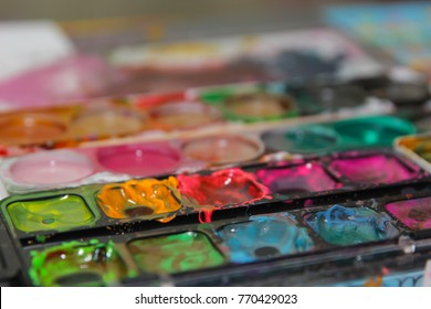 painting with colourful watercolors on the table