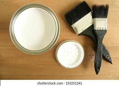 Painting and decorating  top down view of a pot of white paint and brushes