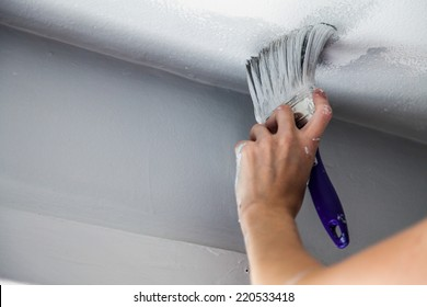 Painting the Edges of the Ceiling with Paintbrush