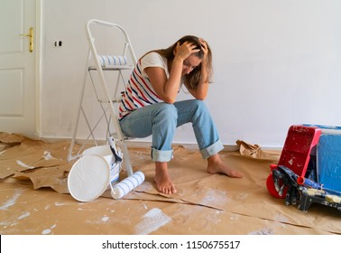 Painting Equipment in the room with blue wall and stressed women