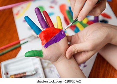 Painting hands of child
