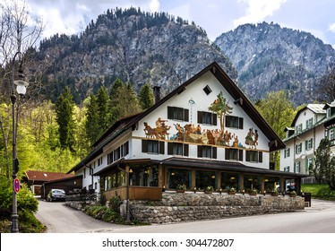 Painting house in Bavarian Alps, Germany.