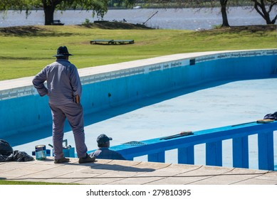 Painting a huge blue Swimming Pool.