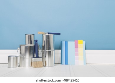 Painting the interior with tins and brushes