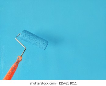 painting interior wall with paint roller