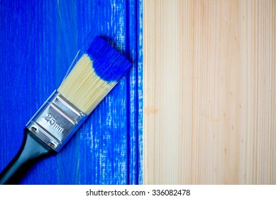 Painting of Light Wooden Planks with Brush and Blue Color Paint