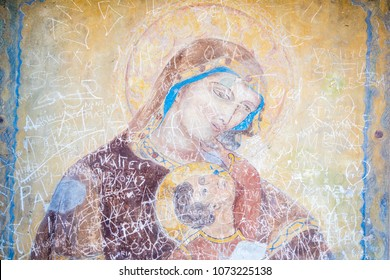 Painting of the Madonna ruined by writings of tourists