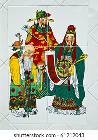 Painting on ceramic wall in Chinese's temple, Image of  three gods of China that mean to the wealthy life.