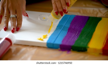Painting rainbow on canvas, gay pride, transsexuality concept, sexual diversity