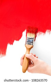 Painting with red and paintbrush on white