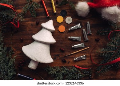 Painting styrofoam Christmas tree, top view flat lay