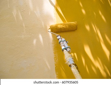 painting a wall with roller.