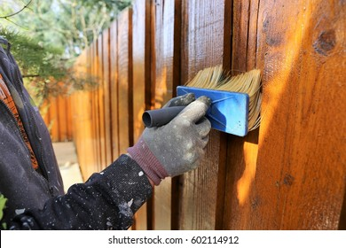 Painting a wooden garden fence