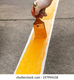 Painting yellow line on the floor