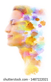 Paintography. Double exposure. Profile portrait photograph of woman with closed eyes blends with colorful hand made painting on white background