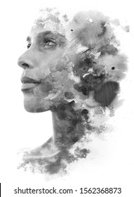 Paintography. Double exposure of woman's profile dissolving into ink brush strokes and shapes, black and white