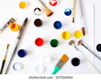 Paints and brushes. Art and craft background, top view.