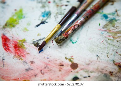 Paints and brushes. Colorful bright artistic brushes and paints. Abstract background with brushes.