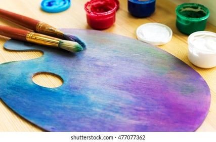 paints, easel, brushes lie on a table by the window. Set the artist.concept art