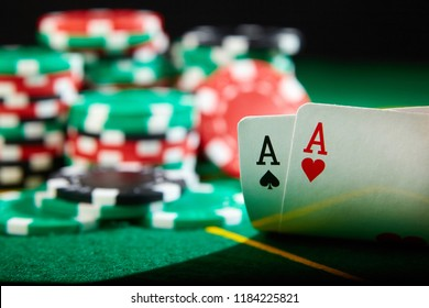 A pair of aces and chips. Blackjack winning hand.
