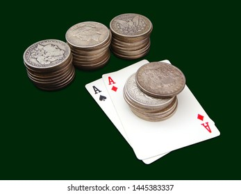 Pair Of Aces With Four Stacks Of Morgan And Peace Type Silver Dollars Over Green Background