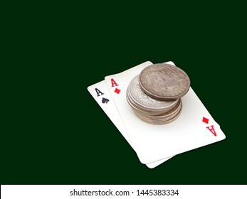 Pair Of Aces With One Stack Of Morgan And Peace Type Silver Dollars Over Green Background