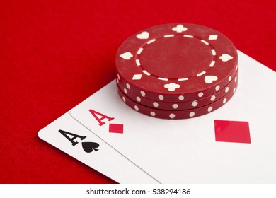 Pair of aces with poker chips