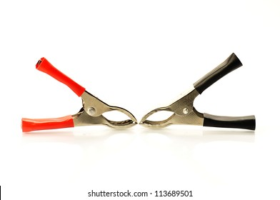 pair of alligator clamps with red positive and negative black color