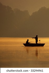 A pair of anglers are fishing on a beautiful golden morning.