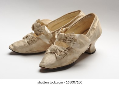 Pair of antique women pretty shoes decorated with bows