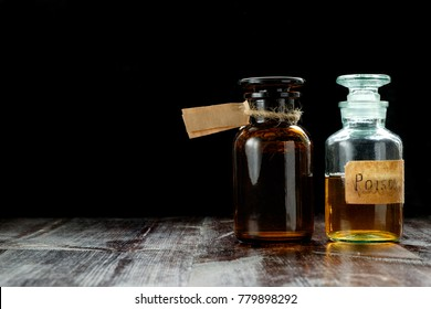 pair of apothecary bottles with potion of poison or tincture